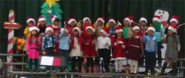 Students perform holiday songs