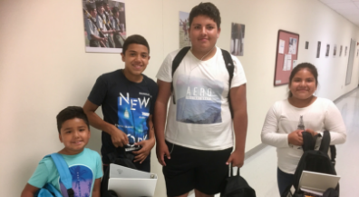 Migrant Program students get backpacks for back to school