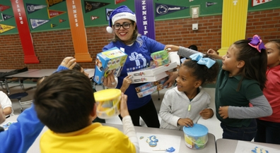 Blue Elves hand out holiday cheer, presents at Putnam