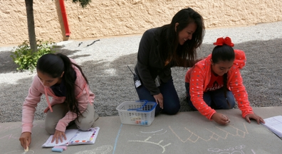 Beall students chalk their favorite poems on sidewalks