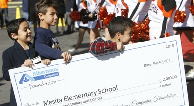 Albertsons celebrates store renovations with checks for EPISD schools