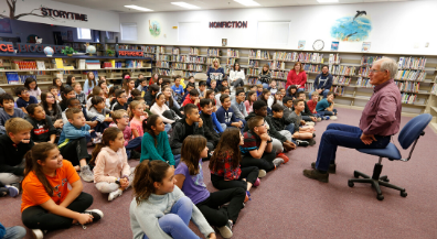 Author helps students embrace love of reading in English, Spanish
