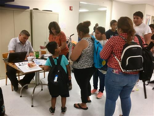 Migrant Program backpack giveaway