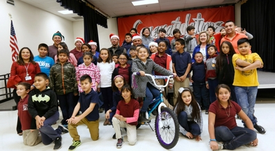 Masons deliver new bikes to deserving Moye students