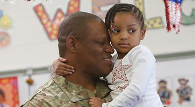 Stanton hero, dad surprises young daughter after long deployment