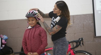 Cooley students receive lesson in bike safety, new helmets