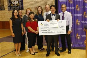 Burges' Jesus Gallardo accepting the Amy Boatright Memorial Scholarship.